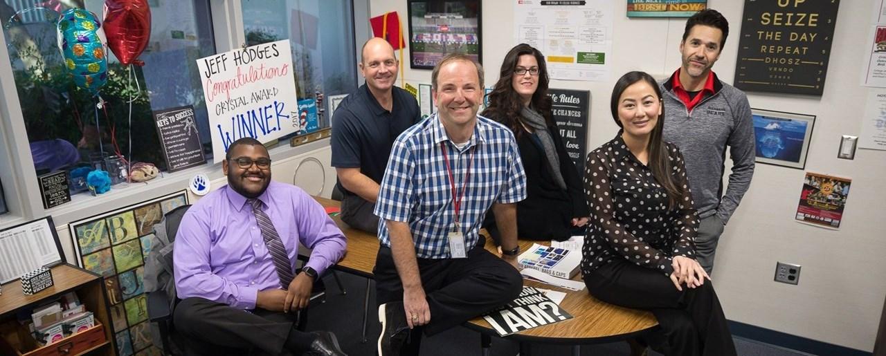 Buchanan staff members sitting in office